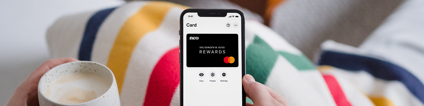 Person holding phone with Neo HBC Rewards App on screen
