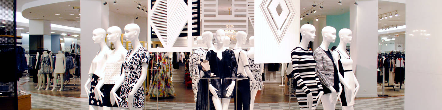 Department store display of mannequins showcasing black and white clothing