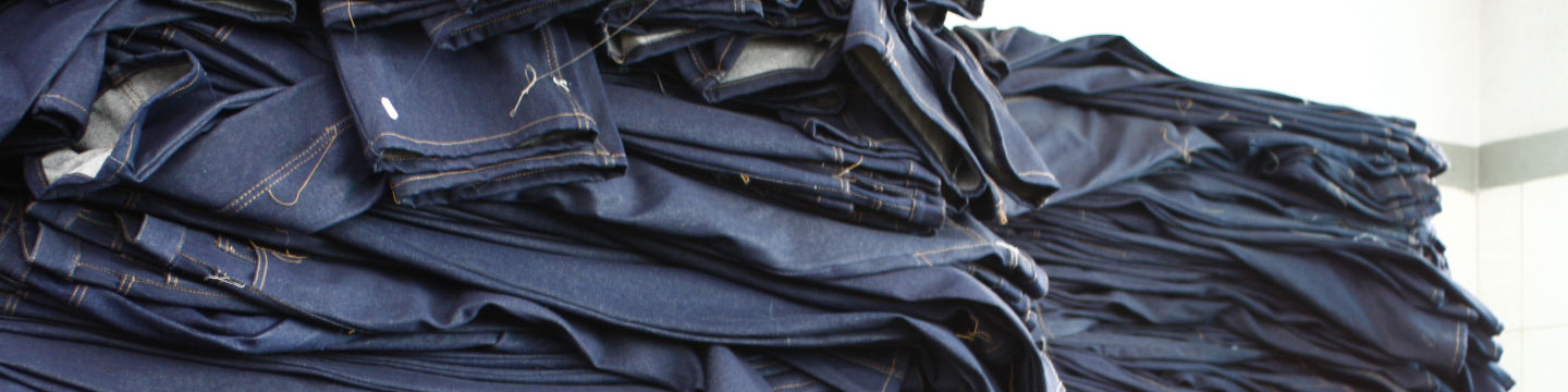 Large pile of jeans during manufacturing process